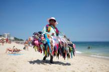 bikini-vendor-ipanema-beach-rio-de-janeiro-brazil-january-selling-bikinis-carries-her-merchandise-along-41293609